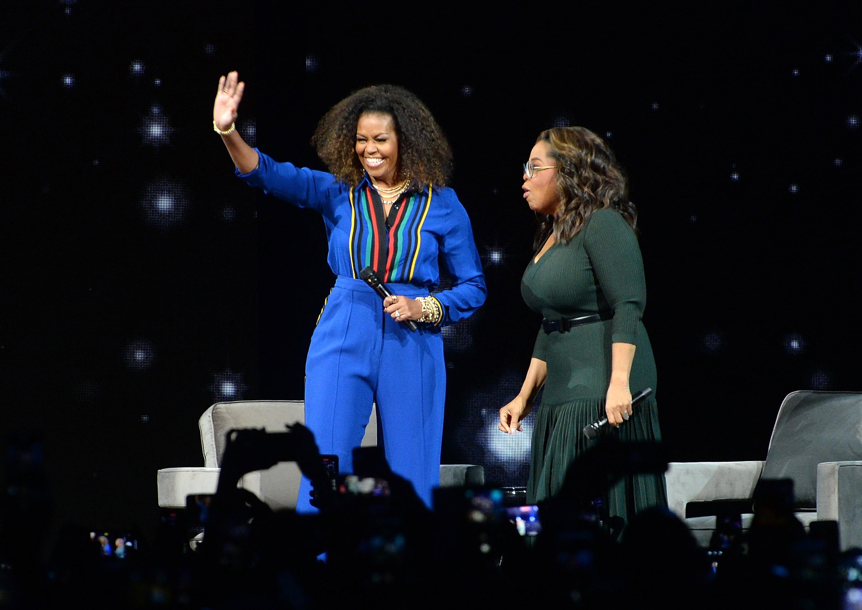 Michelle Obama, Oprah Winfrey titular arena como estrellas de rock